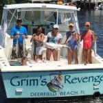 Happy customers with fish caught aboard Grim's Revenge
