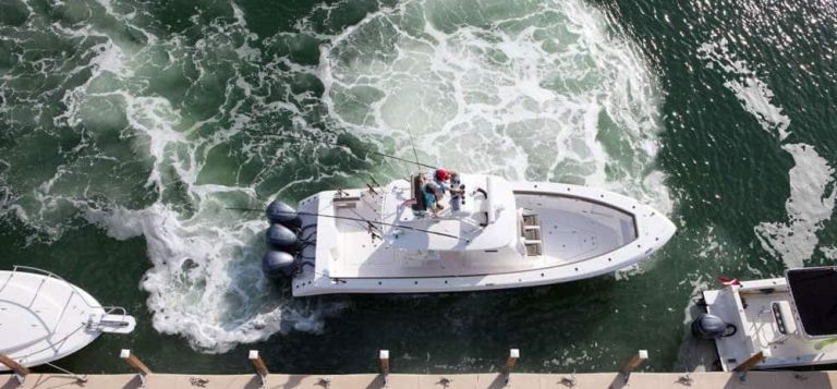 aerial view of boat docking against current