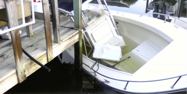 Boat caught under dock from incorrect dock lines