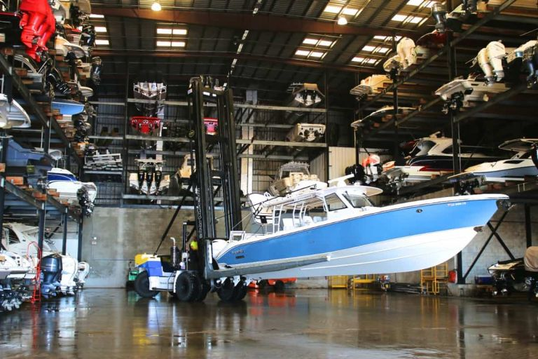 Marine forklift putting a boat away in dry rack storage